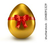single golden egg with red... | Shutterstock . vector #1048091329
