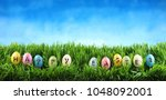 bright colorful easter eggs... | Shutterstock . vector #1048092001