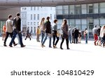 a crowd moving against a... | Shutterstock . vector #104810429