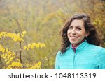 outdoor portrait of happy 40... | Shutterstock . vector #1048113319
