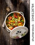 spicy cabbage soup. | Shutterstock . vector #1048128784