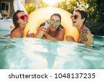 three women friends enjoying... | Shutterstock . vector #1048137235