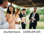 best man giving speech to... | Shutterstock . vector #1048139134