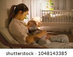 young beautiful mother ... | Shutterstock . vector #1048143385
