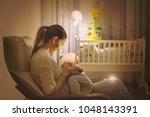 young beautiful mother ... | Shutterstock . vector #1048143391