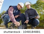 two sewerage workers inspecting ... | Shutterstock . vector #1048184881