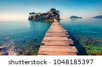Stock photo bright spring view of the cameo island picturesque morning scene on the port sostis zakinthos 1048185397