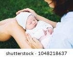 loving mother with her newborn...   Shutterstock . vector #1048218637