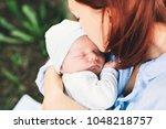 loving mother with her newborn... | Shutterstock . vector #1048218757