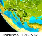 kosovo highlighted in red on... | Shutterstock . vector #1048227361