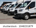 number of new white minibuses... | Shutterstock . vector #1048231879