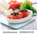 baked tomatoes stuffed with... | Shutterstock . vector #1048243135