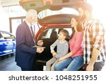 happy family buying a new car... | Shutterstock . vector #1048251955