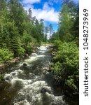 rushing river rapids near...   Shutterstock . vector #1048273969