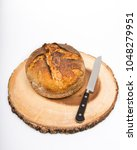 a fresh loaf of round artisan... | Shutterstock . vector #1048279951