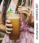 young girl drinking iced lemon... | Shutterstock . vector #1048351387