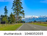 road to somewhere. a new... | Shutterstock . vector #1048352035