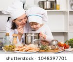 woman with her daughter are... | Shutterstock . vector #1048397701