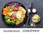 buddha bowl dish with chicken... | Shutterstock . vector #1048399849