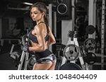 fitness girl exercising with... | Shutterstock . vector #1048404409