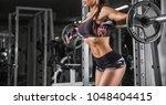 fitness girl exercising with... | Shutterstock . vector #1048404415