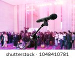 microphone close up on blurred... | Shutterstock . vector #1048410781