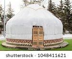 white yurt on the street in... | Shutterstock . vector #1048411621