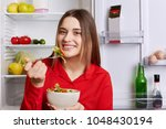 photo of good looking young... | Shutterstock . vector #1048430194