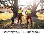 two arborist men standing...   Shutterstock . vector #1048450561