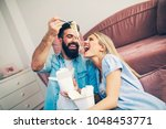 modern young couple eating and... | Shutterstock . vector #1048453771