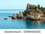 taormina summer ionian sea... | Shutterstock . vector #1048460185