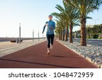 active girl jogging on the...   Shutterstock . vector #1048472959