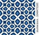 seamless ikat pattern in blue... | Shutterstock . vector #1048475185