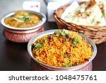 set of indian food. biryani in... | Shutterstock . vector #1048475761