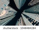 upward night view on high... | Shutterstock . vector #1048484284