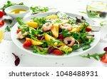 fresh avocado  shrimps  mango... | Shutterstock . vector #1048488931