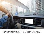 hands on wheel driving car on... | Shutterstock . vector #1048489789