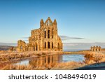 whitby abbey  north yorkshire ... | Shutterstock . vector #1048494019
