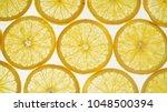 orange thinly sliced lobules... | Shutterstock . vector #1048500394