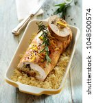 roast loin of pork stuffed with ... | Shutterstock . vector #1048500574