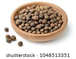 dried herb  allspice in the... | Shutterstock . vector #1048513351