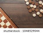 top view of wooden draughts...   Shutterstock . vector #1048529044