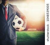 soccer manager holding football ... | Shutterstock . vector #1048539005