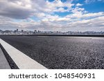 empty asphalted road with...   Shutterstock . vector #1048540931