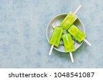 frozen fruit kiwi juice in a... | Shutterstock . vector #1048541087