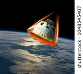 a space capsule reenters the... | Shutterstock . vector #1048545407