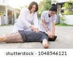 emergency cpr on a man who has... | Shutterstock . vector #1048546121