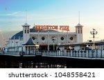 brighton pier  brighton and... | Shutterstock . vector #1048558421