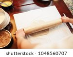 chef roll out the dough with... | Shutterstock . vector #1048560707