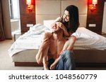 sexy love couple hugs and have... | Shutterstock . vector #1048560779